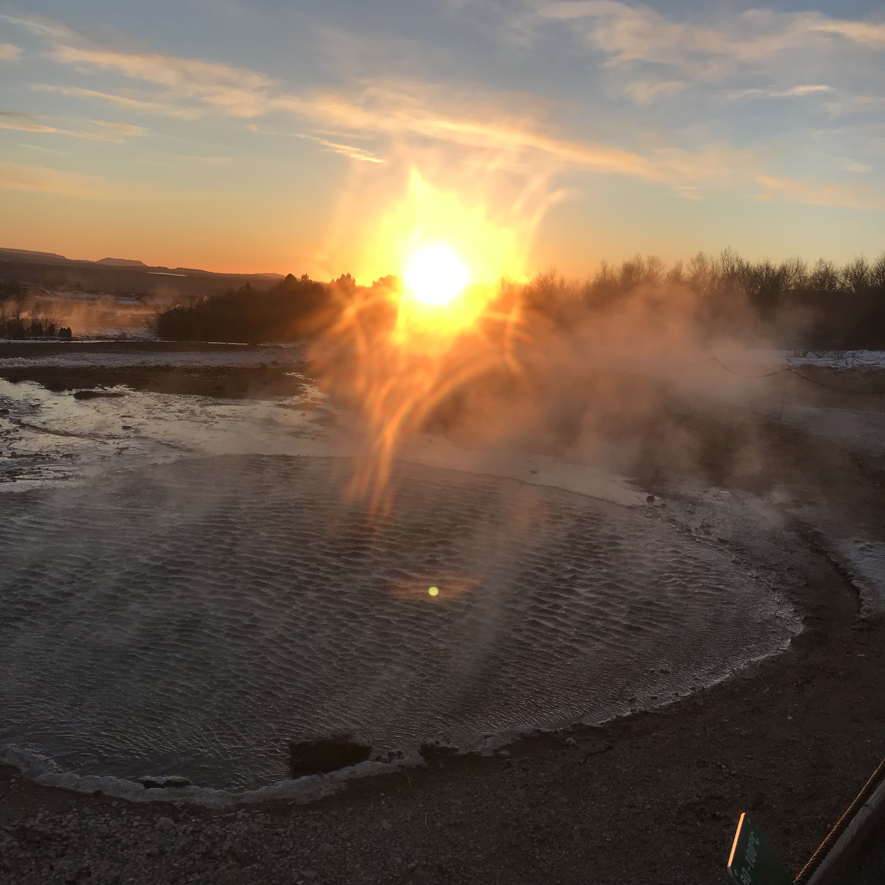 Geysir had just erupted and the heat distorted the sun through the steam in this picture